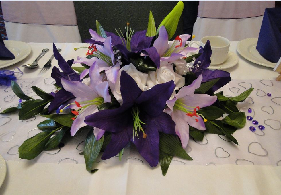 Guest Table Arrangement - Small Display With Lilac & Purple Star Gazer Lilies & White Roses