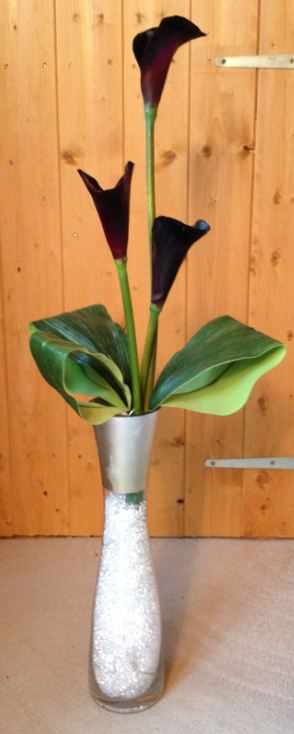 Guest Table Arrangement - Tall Vase Display With Crystals In Vase, Lights, Aspidistra Leaves & Purple Calla Lily
