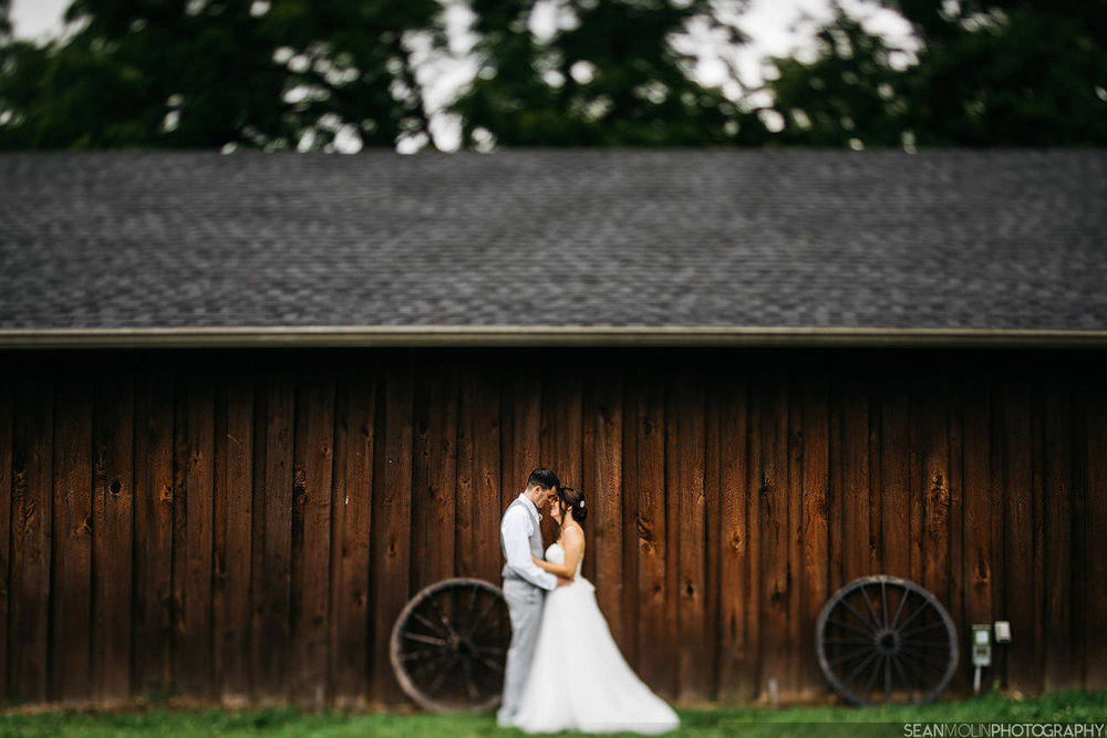 029-bride-groom-tilt-shift-45mm-portrait-barn-natural-light-zionsville-indiana-creative.jpg