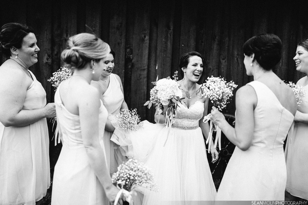 043-bridesmaids-candid-barn-portrait-group-wedding-barn-zionsville-jessica-uhlir-black-white.jpg