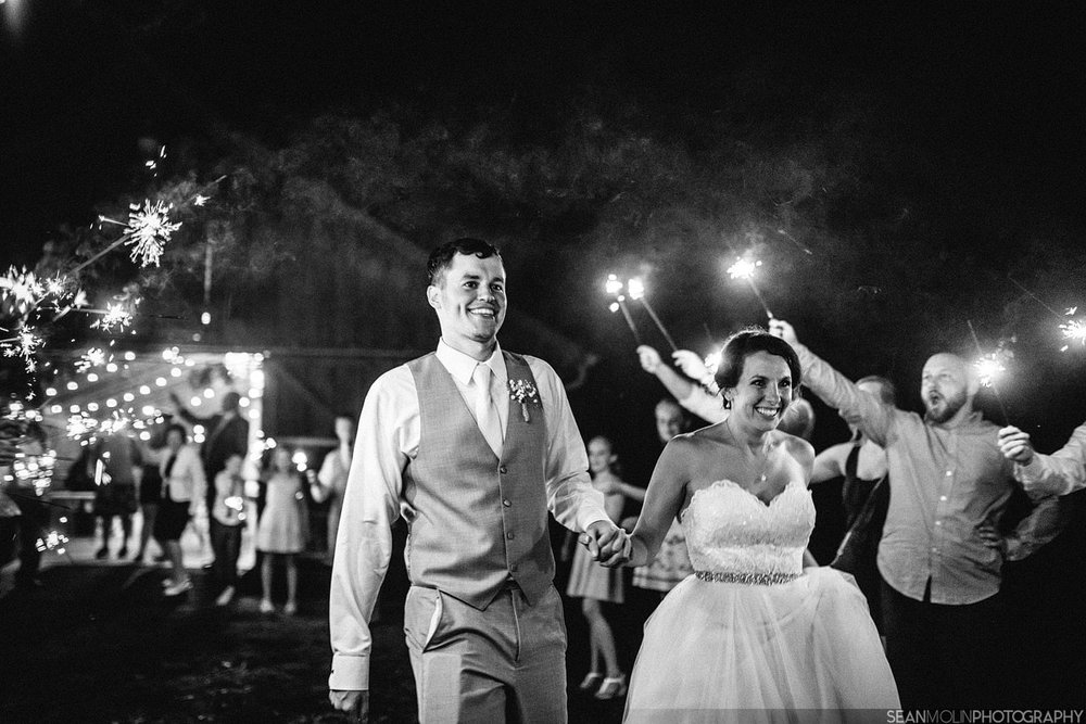112-sparkler-exit-wedding-night-barn-zionsville-jessica-eric-uhlir-indiana.jpg