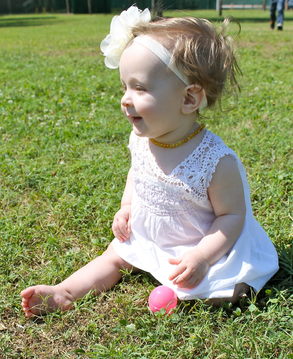baby in vintage white Easter dress
