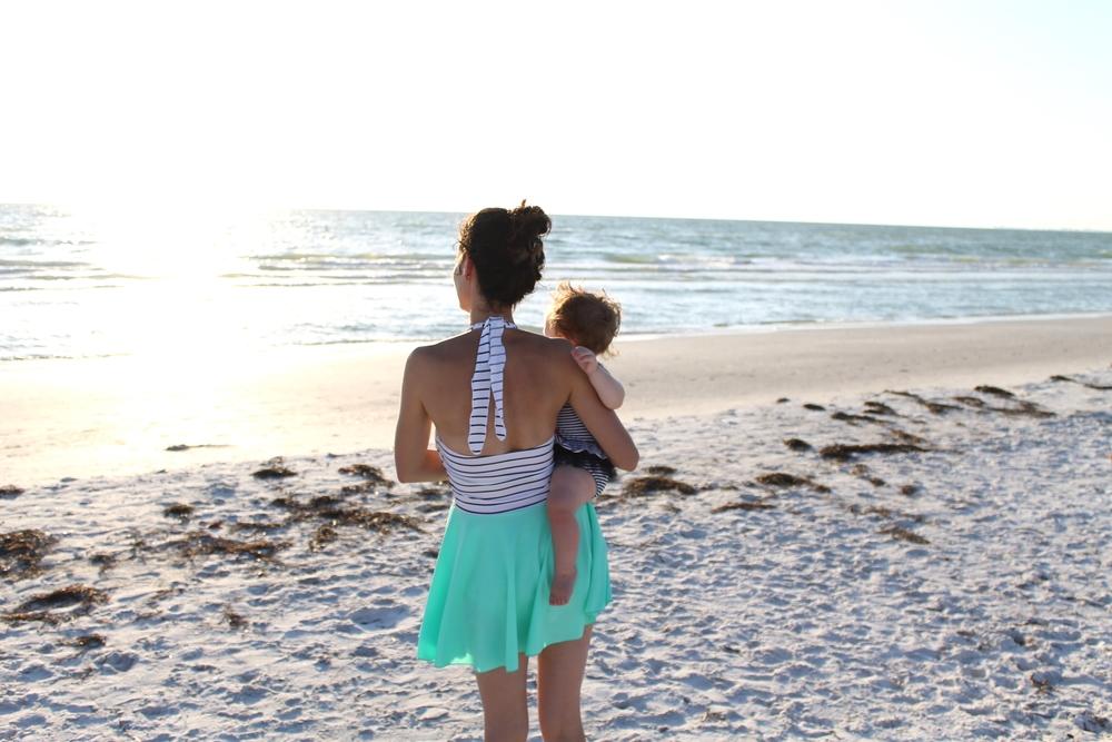 mama and baby at the beach