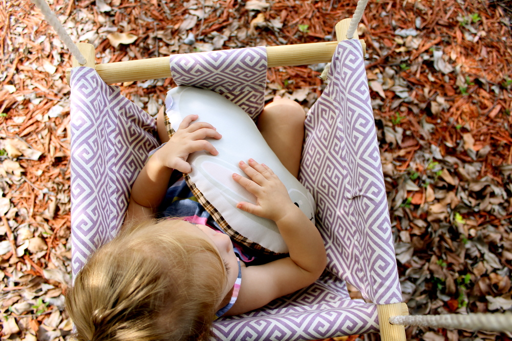 baby girl in handmade swing