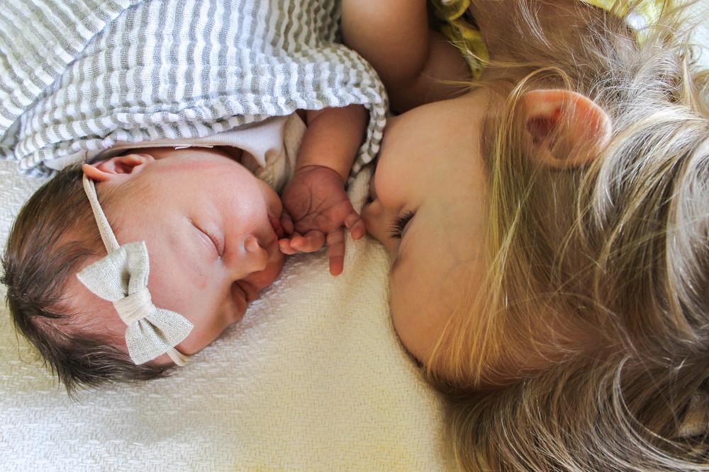 big sister and newborn photo, little unicorn striped swaddle