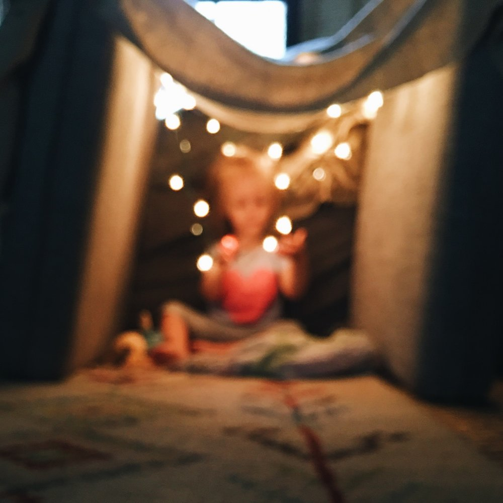 twinkly lights and a fort