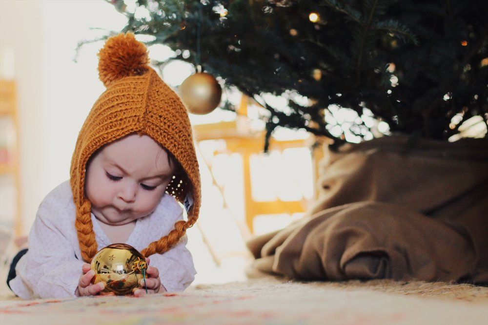 baby with Christmas ornament