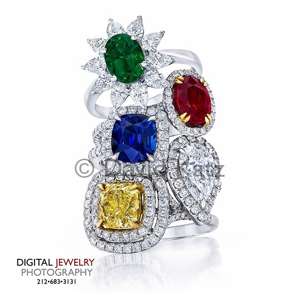 Let's start Monday out right, with a knock out stack ring photo. #stackrings #yellowdiamondring #rubyring #ringstack #haloring #emeraldring