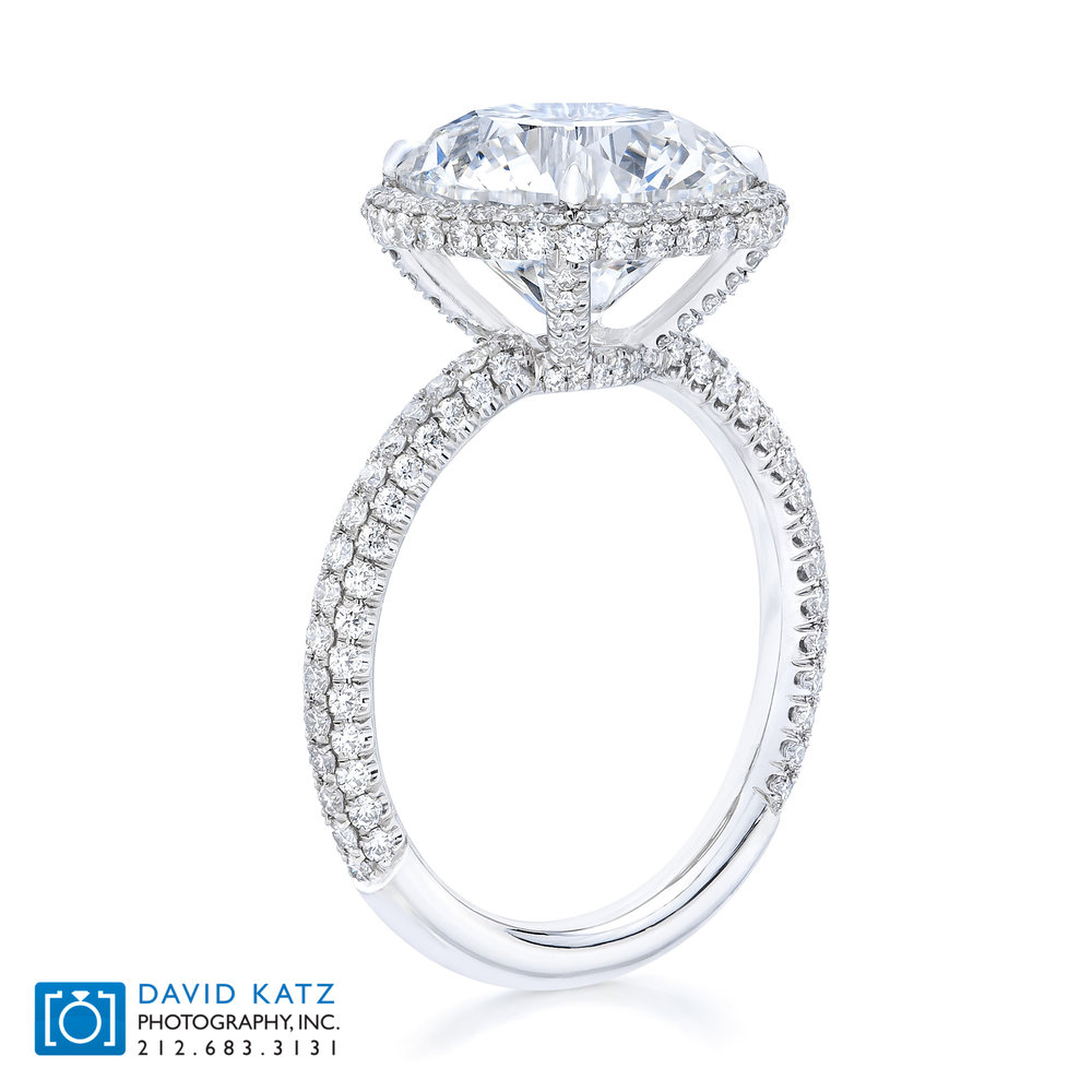 Round Halo Diamond Ring Standing.jpg