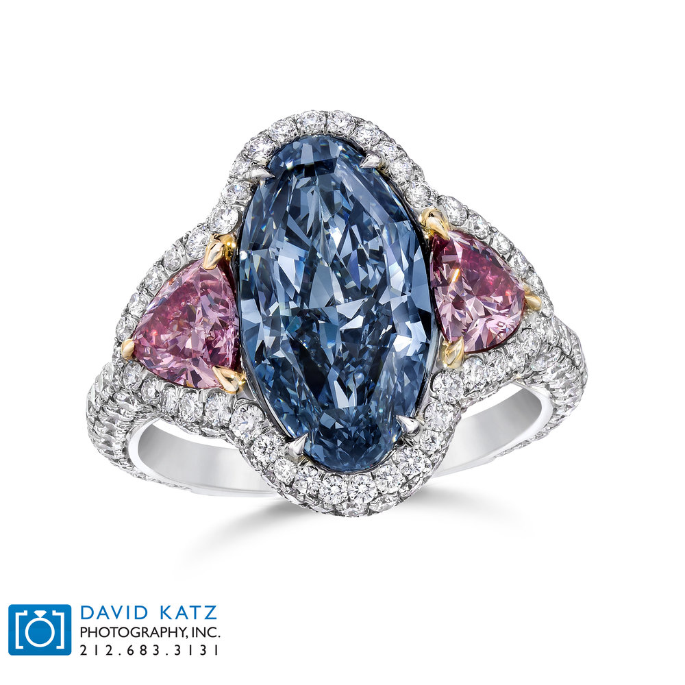 Pink and Blue diamond Ring on white Standing_NEWLOGO.jpg