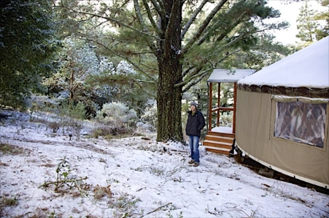Lytle at first snow in front of the yurt he built in the Santa Cruz Mountains of Northern California