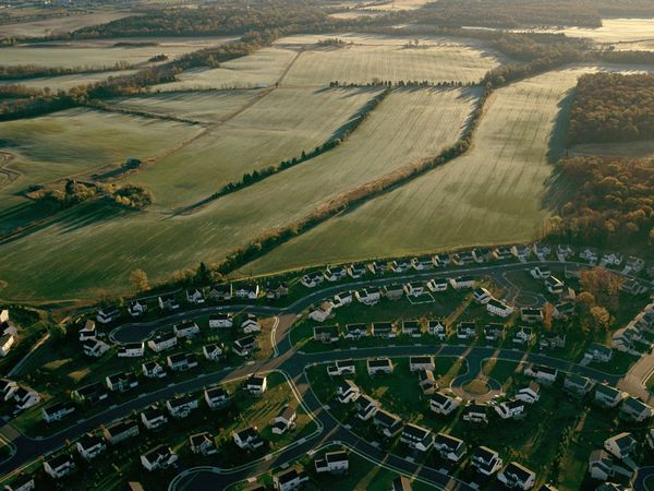 Greenbelts exist to check the unrestricted sprawl of large built up areas