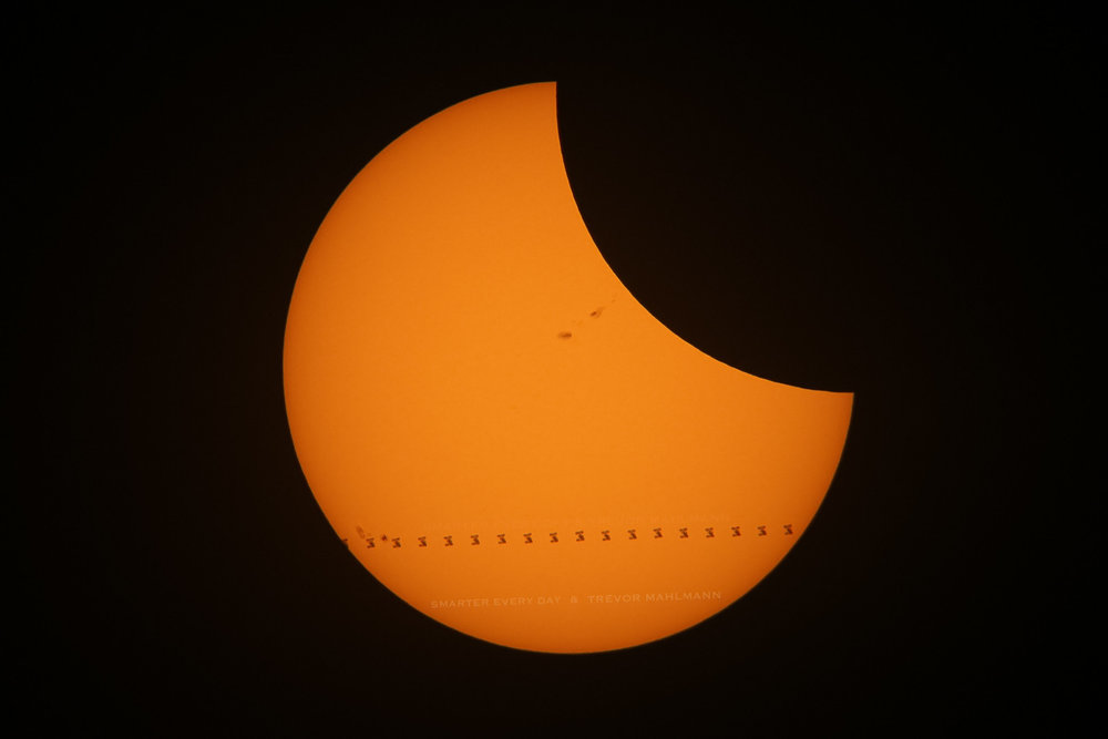 All of the planning, hard work, coordination and math paid off! We caught the ISS in transit across the eclipse. Click HERE to order this print from Trevor's shop.