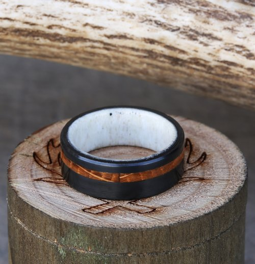 black zirconium wedding band with whiskey barrel inlay and antler lining available in titanium silver black zirconium or 10k gold