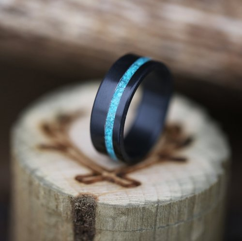 fire treated black zirconium wedding ring with hand crushed turquoise inlay handcrafted by