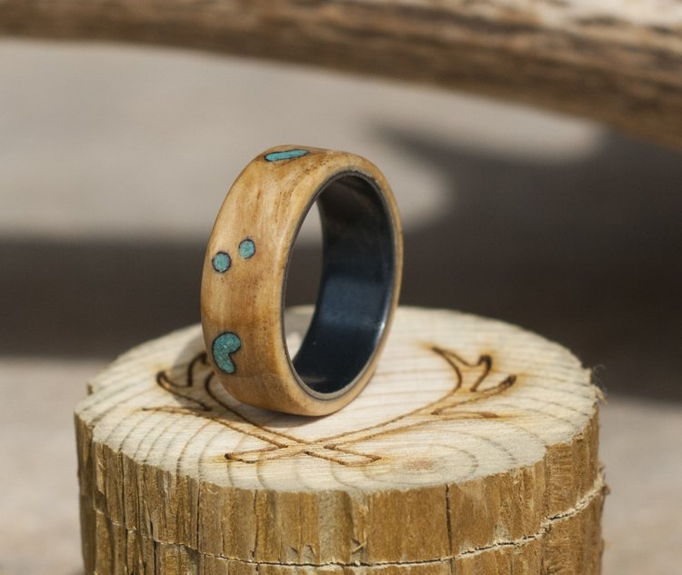 black zirconium wedding band with buckeye burl turquoise inlays