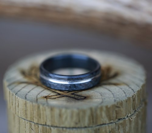 hammered black zirconium wedding band handcrafted by staghead designs
