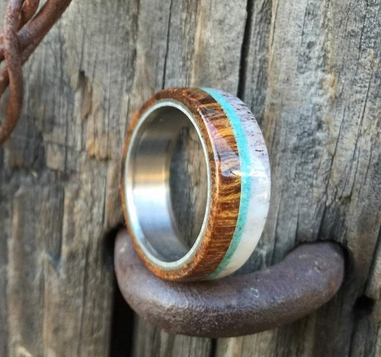 the banner wood antler with a tuquoise inlay set on a rustic - Wood Wedding Ring