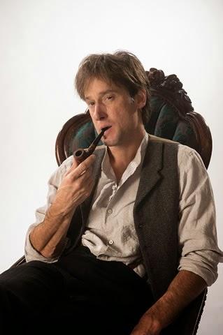 Adams as Holmes
