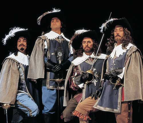 Peter Sham (left) as Porthos, Don Burroughs as D'Artagnan, Gary Armagnac as Athos, and David Ivers as Aramis in The Three Musketeers, 1996.