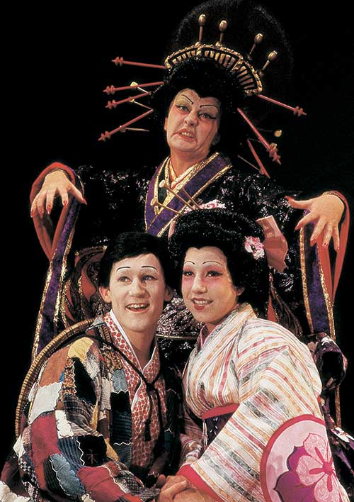 Doug Scholz-Carlson (left) as Nanki-Poo, Laurie Birmingham as Katisha, and Erin Annarella as Yum-Yum in The Mikado, 1996.