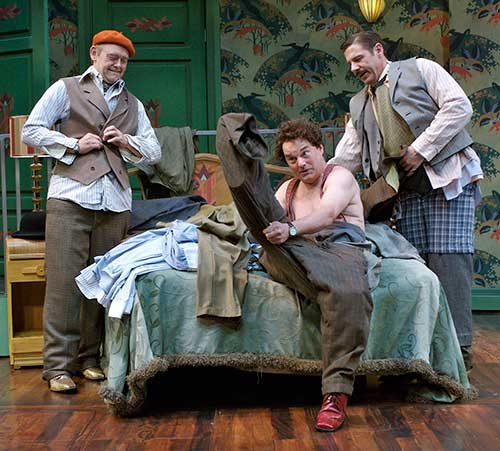 A. Bryan Humphrey (left) as Harry Binion, Rick Ford as Faker Englund, and Brian Vaughn as Gordon Miller in Room Service, 2006.