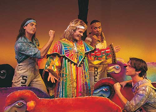 Will Peters (left) as Simeon, Joseph Heninger-Potter as Joseph, René Thorton Jr. as Reuben, and Matt Bomer as Isaacher in Joseph and the Amazing Technicolor Dreamcoat, 1998.