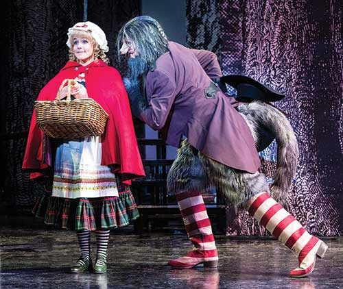Deanna Ott (left) as Little Red Ridinghood and Peter Saide as Wolf in the Utah Shakespeare Festival's 2014 production of Into the Woods.