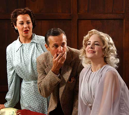 Carole Healey (left) as Ruth, Arthur Hanket as Charles, and Stephanie Erb as Elvira in the Utah Shakespeare Festival's 2004 production of  Blithe Spirit.