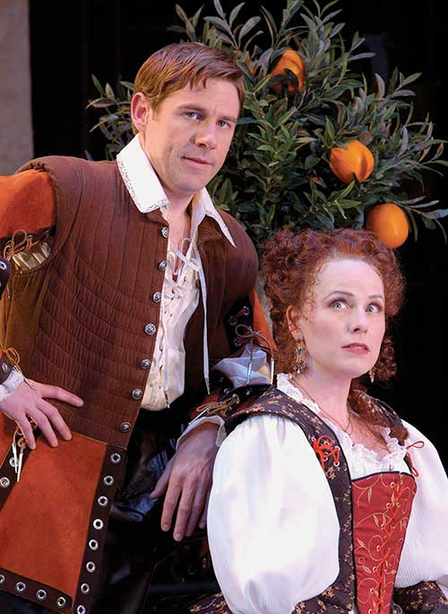 Brian Vaughn (left) as Benedick and Victoria Adams as Beatrice in the Utah Shakespeare Festival's 2003 production of Much Ado About Nothing. (Photo by Karl Hugh. Copyright Utah Shakespeare Festival 2003).