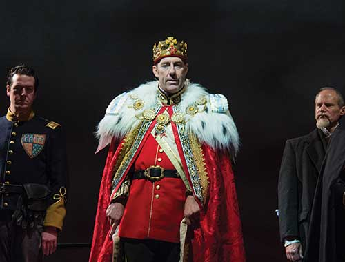 Drew Shirley (left) as Duke of Aumerle, David Ivers as Richard II, and John Oswald as Sir Stephan Scroop in  Richard II,  2013.