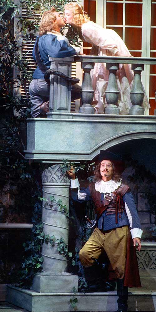 Tom Humphreys (top left) as Christian de Neuvillette, Gina Nagy as Roxane, and Randy Moore as Cyrano de Bergerac in Cyrano de Bergerac, 1992.