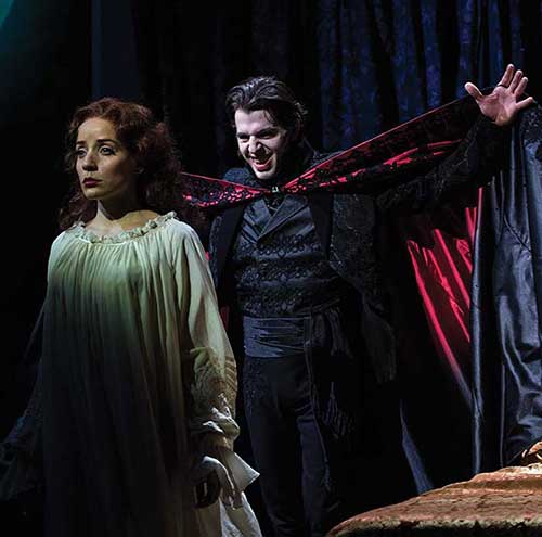 Jamie Ann Romero (left) as Lucy and Tyler Pierce as Dracula in the Utah Shakespeare Festival's 2015 production of Dracula.