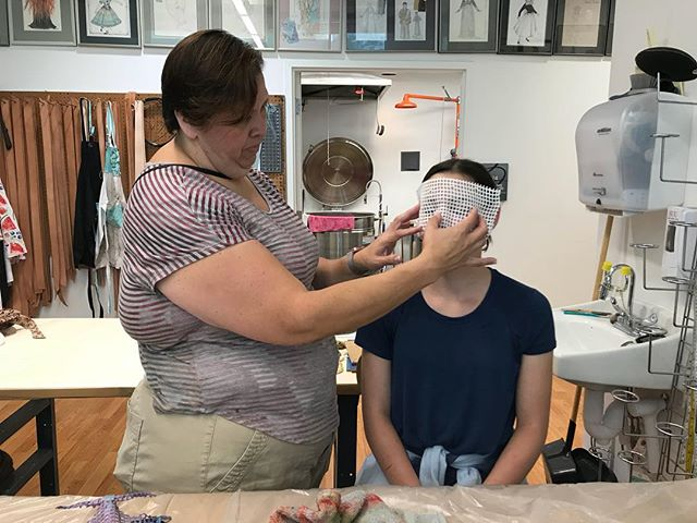 "Ross Lazaro, the Festival's Costume Crafts Supervisor, uses thermal plastics to create a custom fit mask for a guest during the ""Shakespeare U: Art of Mask Making"" workshop. There is another workshop on August 2. Buy tickets online or by calling the box office."