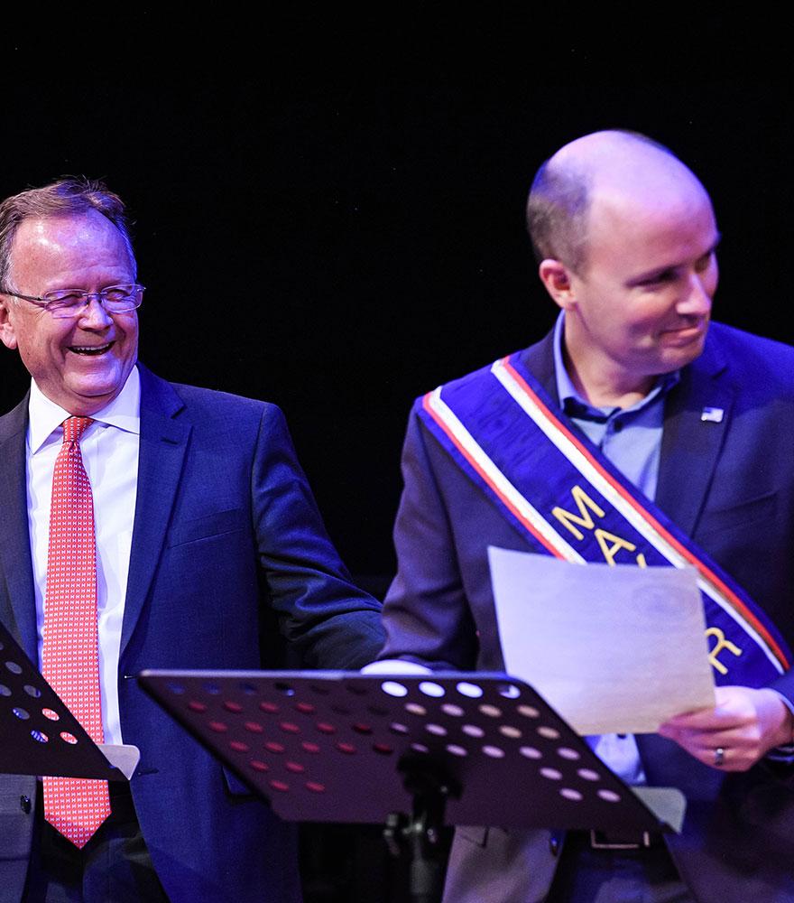 J. Stuart Adams (left), speaker of the House of Representatives, and Spencer J. Cox, lieutenant governor, perform.