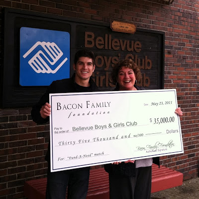 Tony Bacon of the Bacon Family Foundation presents a check to Kathy Haggart, President & CEO of Boys & Girls Clubs of Bellevue.