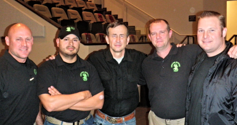 Colonel Grossman (center) with the employees of Sheepdog Defense Group.