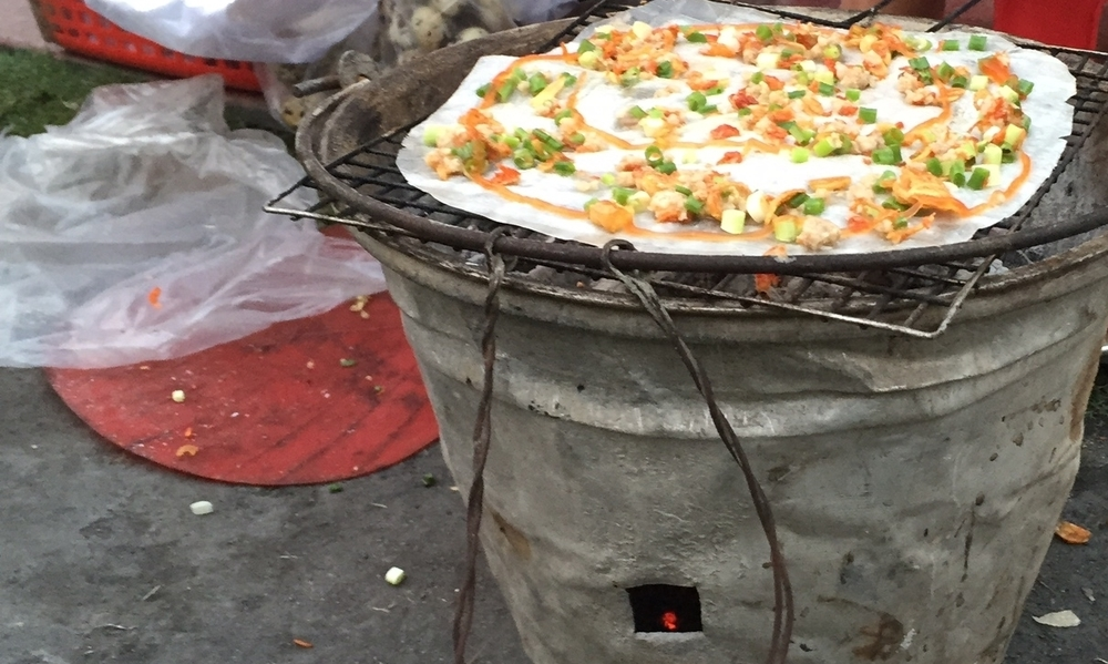 Grilling with coals and a bucket at a park in Saigon