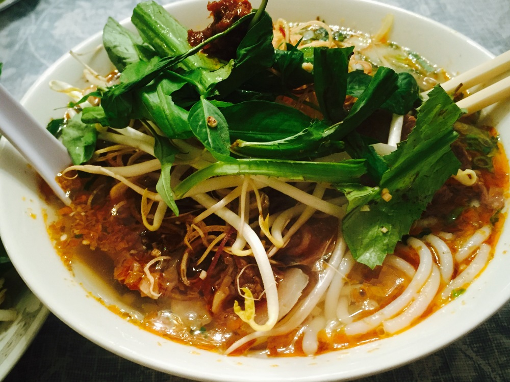 Bún Bò Huế : Huế, Vietnam.  This bowl of bún (noodle) was made by our sister Chi Thu (Sister Thu).  Her chili oil is superior to all.  Thai reps her recipe but it's one of those things, like Heinz or Hellmann's, if you know who makes it the best then there is no reason to re invent the wheel.  What makes it all the more special is that she uses fresh lemon grass to cool the heat from the dried chili.  Her broth is CLEAR, and she lets the flavor from the bones and aromatics shine.