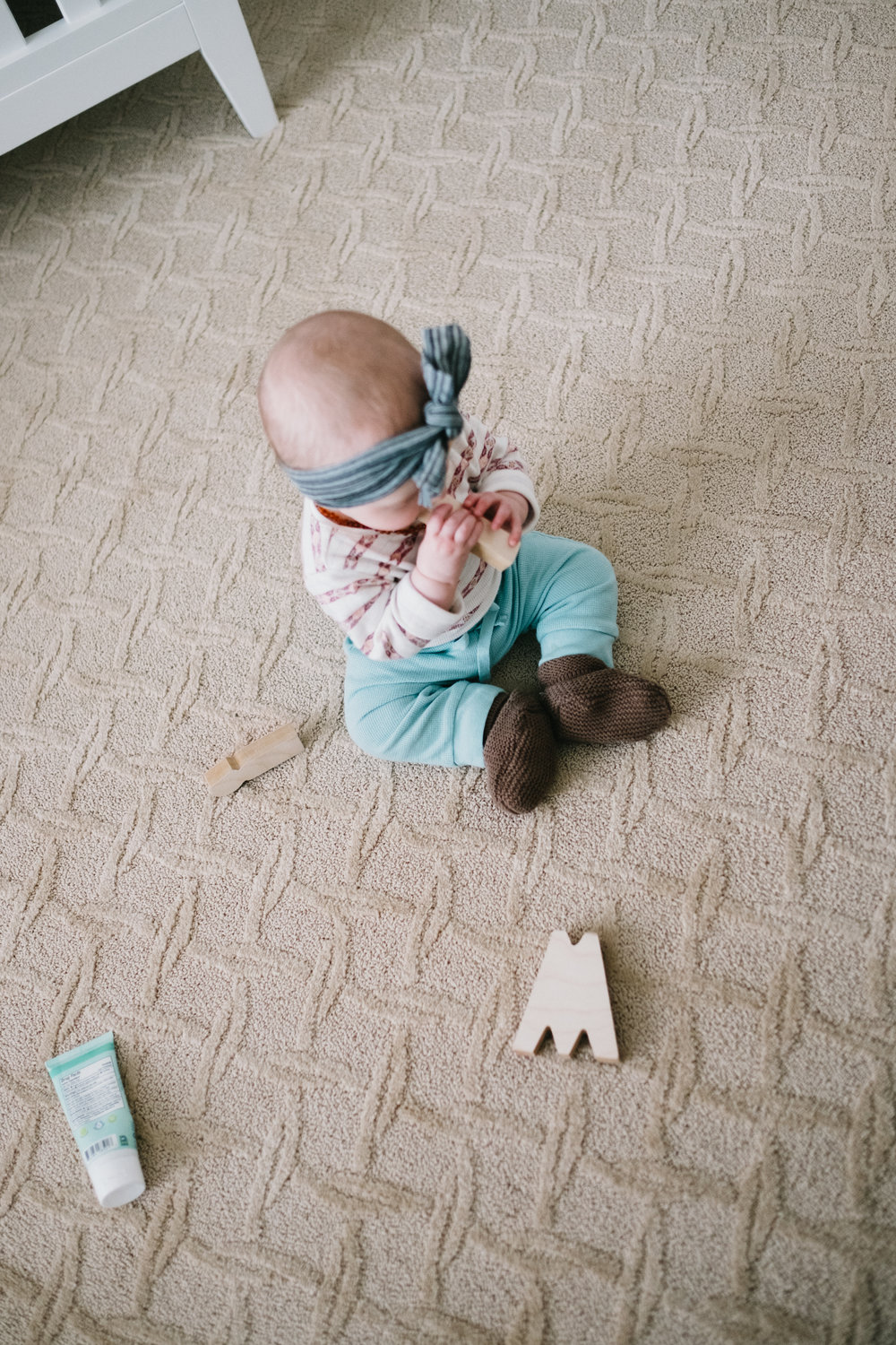 Baby on floor with blocks