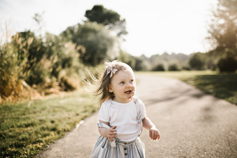 Smiling toddler girl on path
