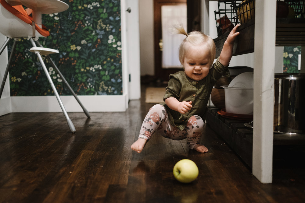 Baby playing with apple