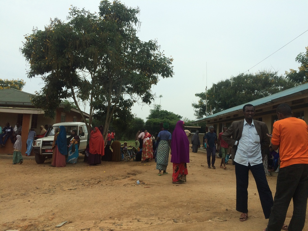 Refugees lingering outside the Resettlement Office