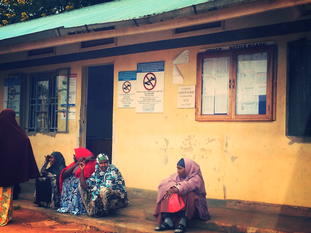 Somali women waiting for refugee status updates to be posted on the UNHCR Notice Board
