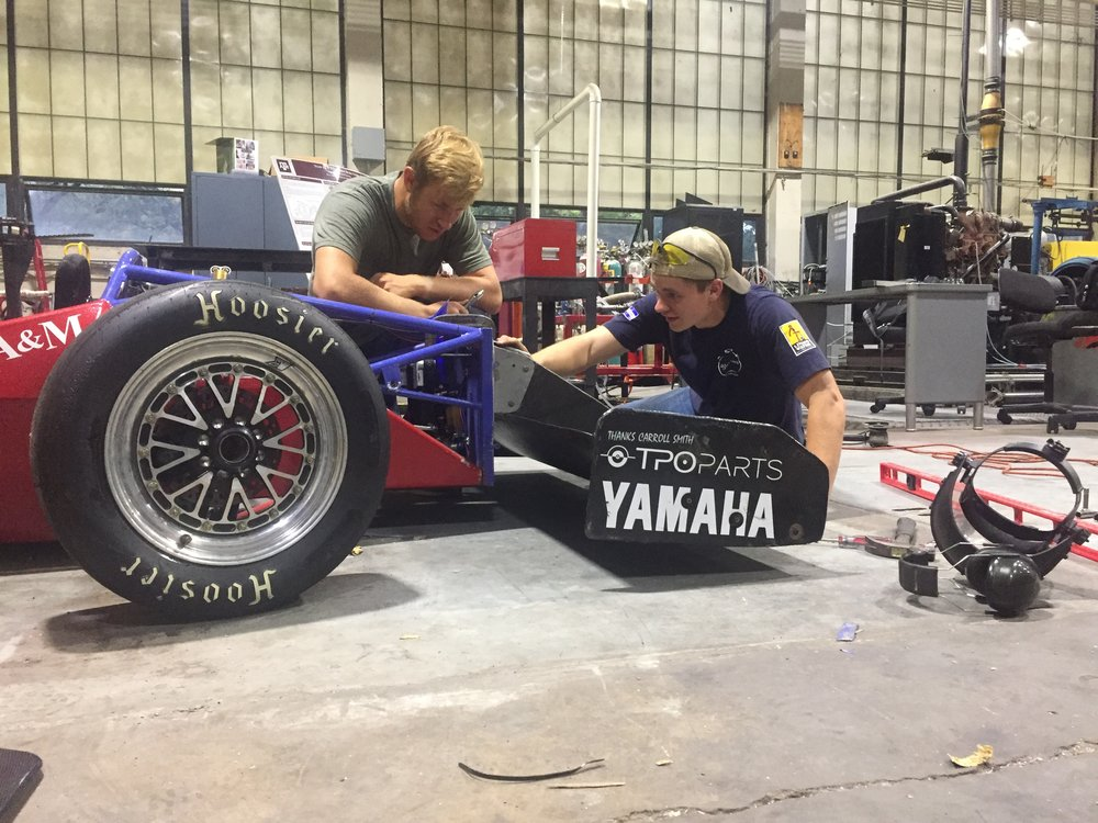 Apprentices maintaining the 2015 car