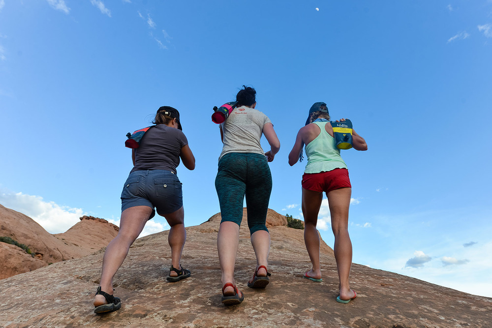 Photo Credit: @shutterschwab  //\\ Bold Betties hike up a rock formation in Moab, UT.