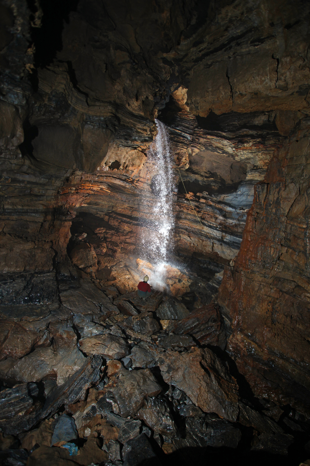 The junction room of Li Nita and Sótano de San Agustín, a connection that established the first 1000-meter deep cave outside of Europe. It is also the point of access for upstream exploration in Red Ball Canyon.