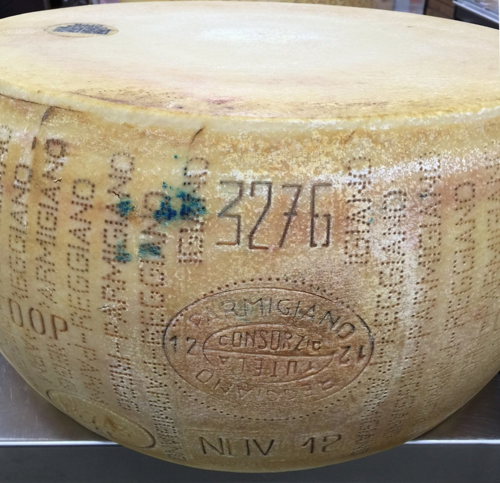 Certification mark – Parmigiano Reggiano Consorzio Tutela and year of production. 3276 identifies the producer