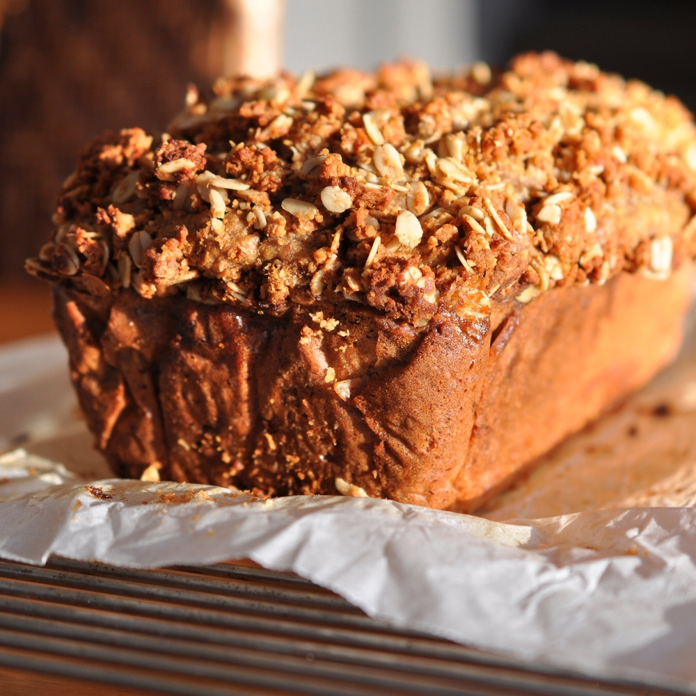 Moist banana loaf studded with crunchy toffee and topped with Anzac crumble
