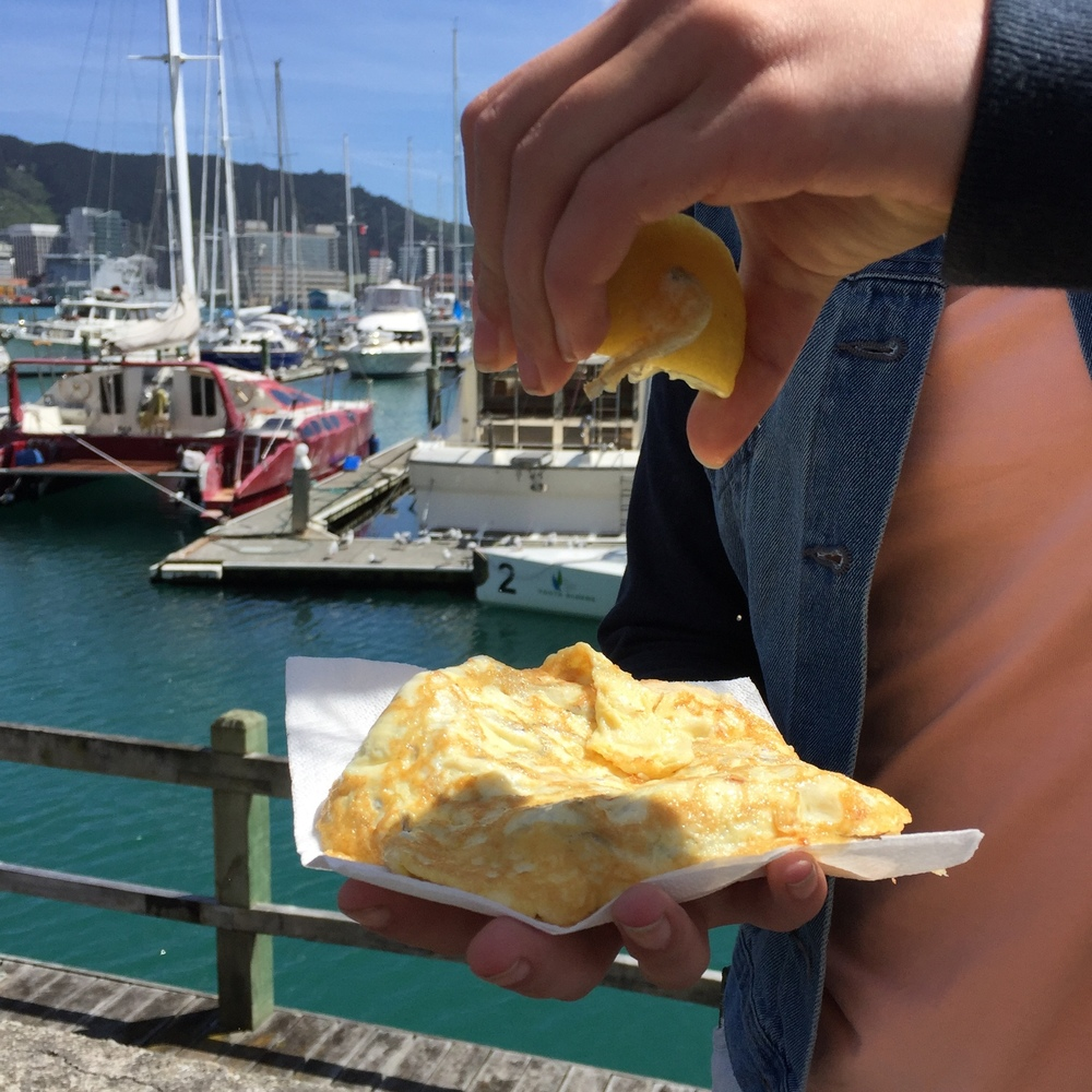 Enjoying a whitebait fritter dockside